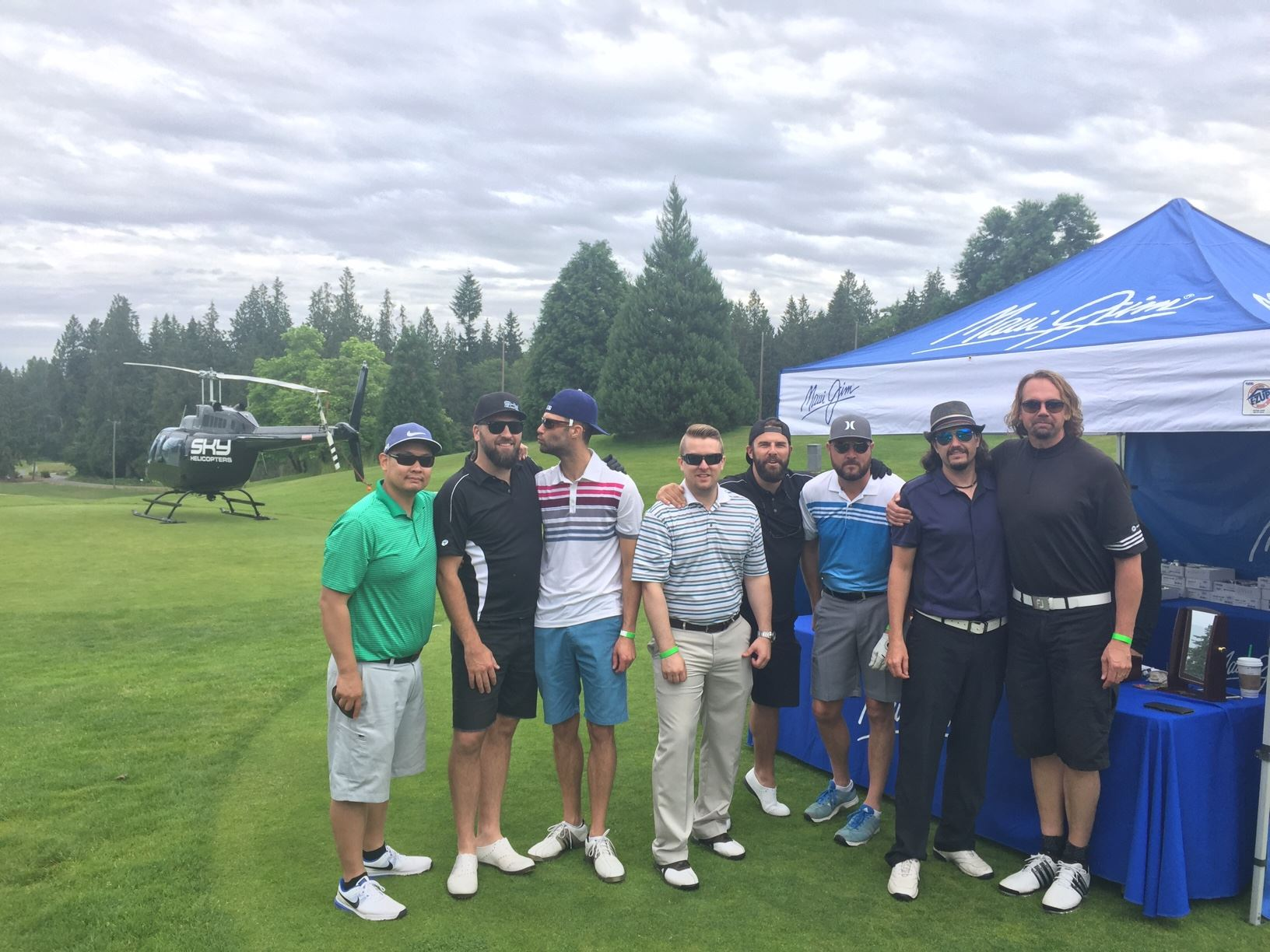 Apex Wireless Staff at a golf course with a helicopter in the back